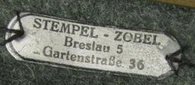 Stoffetikett Stempel Zobel Breslau