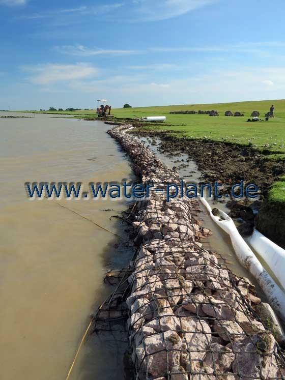Einbau von Steinwalzen im Tidebereich der Ems