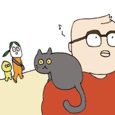 #月¢日 繁華街にて。なにげなく猫乗せる男性。なにげなく乗ってる猫。