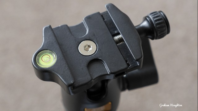 "The ""ARCA"" style mounting plate on a ball head tripod mount."