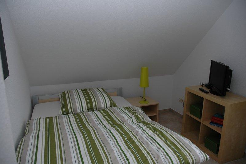 Kinderzimmer mit 1,40 m Bett