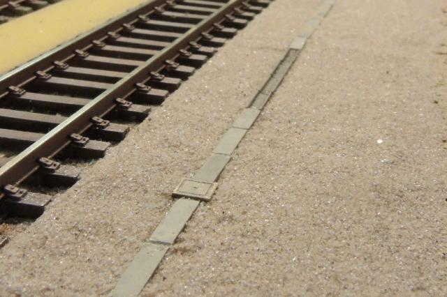 caniveaux et sable de piste