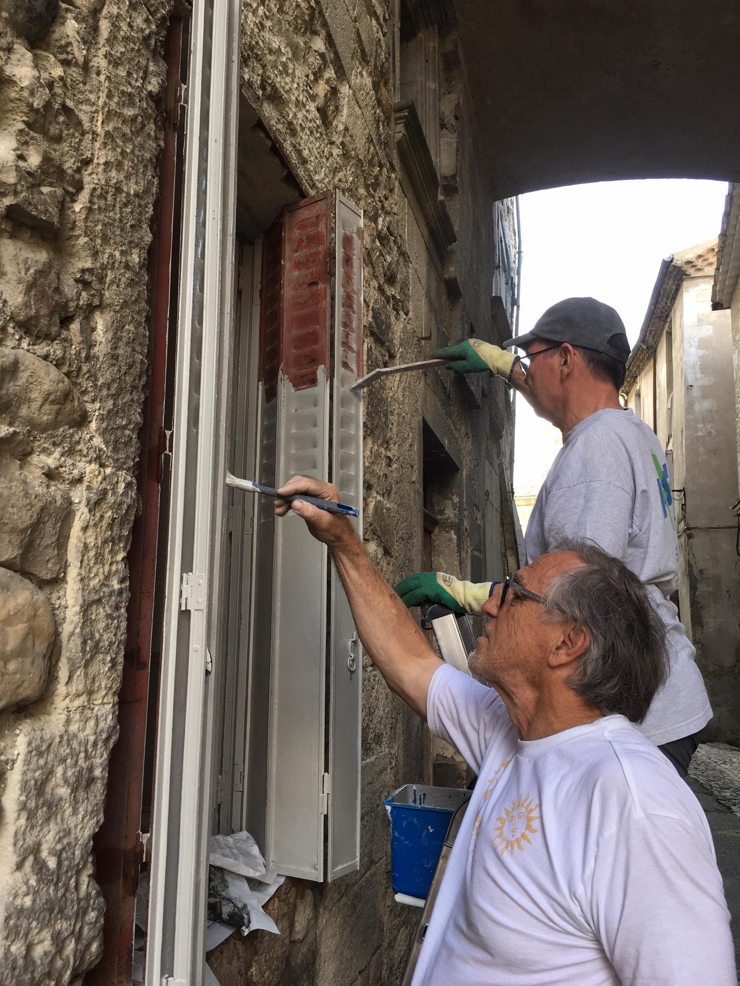 Guy Daygue et Dani Suter en train de peindre