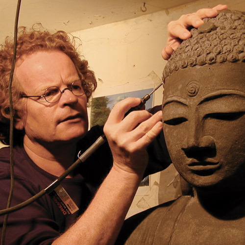 Harald Fauska at his studio, finishing a buddha statue