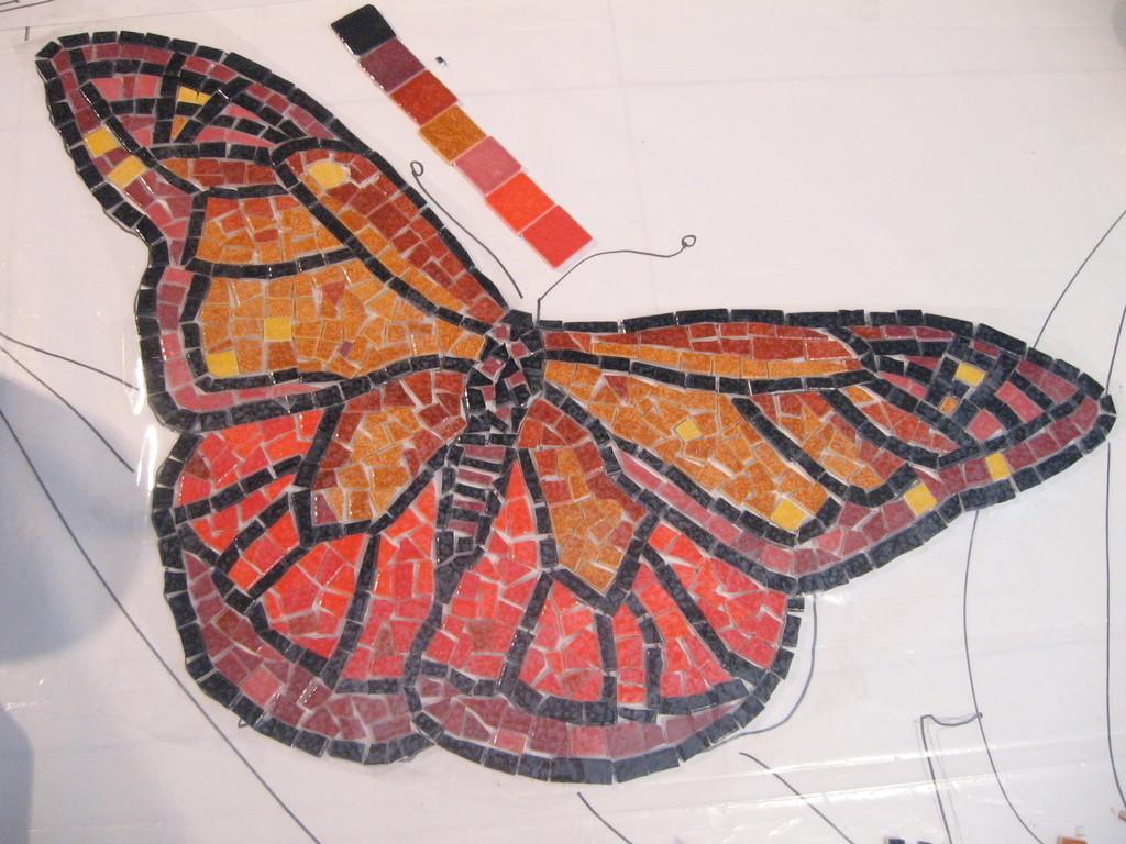 mosaïque: le premier papillon