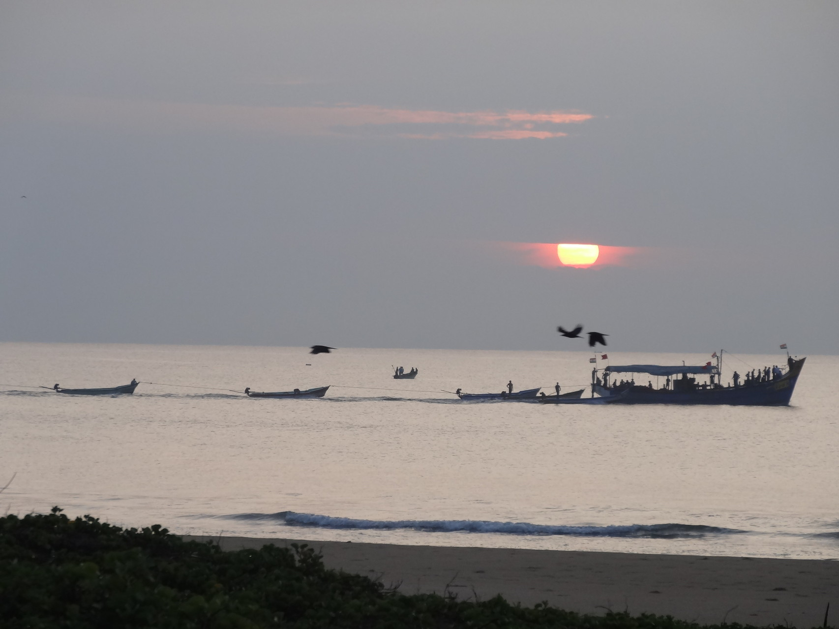 Levé de soleil au départ des pêcheurs