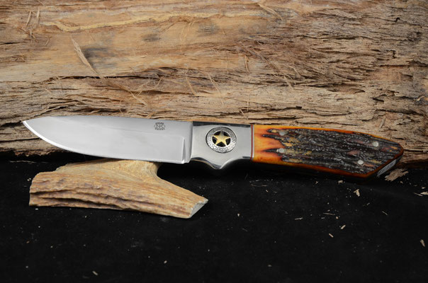 """#46 Large full tang drop point.  Blade length 4 1/2"""" Overall 10 1/2"""" 440c steel.  Handle Red Dyed Stag Bone.  Nickel silver golster with star on both sides.  Maker RD Nolen  SOLD"""