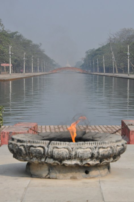 Eternal Flame with World Peace Pagoda in the background