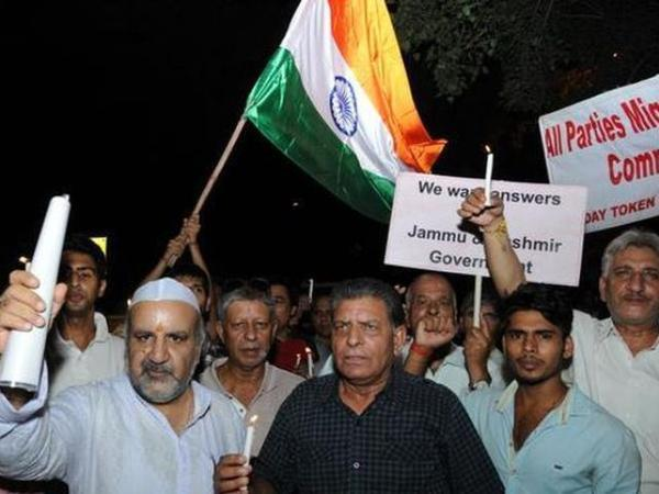 Members of the All Parties Migrants Co-ordination Committee staging a protest and candle march at Jantar Mantar in New Delhi to pay homage to Uri martyrs and demanding that the government take strict action against separatists and their mentors across...