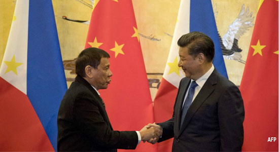 President Rodrigo Duterte (L) and his Chinese counterpart Xi Jinping shake hands after a signing ceremony in Beijing on October 20, 2016. AFP