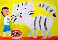 「おばあちゃんちのネコ」 作者が生まれる前からいるネコさんだそうです。猫じゃらしで遊んであげて楽しそう。