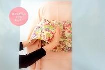 「森田空美のシンプル華着付け」の背表紙。着せるためのコツがわかる!という言葉と名古屋帯で結ぶ文庫結びの写真が載っています。