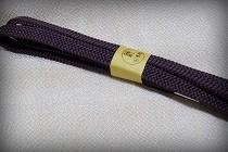 小島先生が組まれた「平唐組」の帯締め。シックな滅紫(けしむらさき)色です。