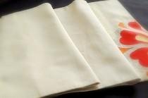 綴れ織の帯を短く切った、ひだ折り練習用の帯。