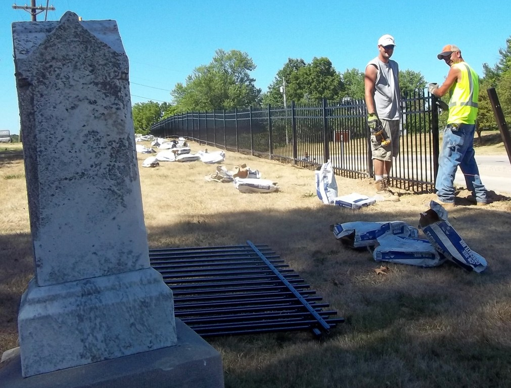 Josh (on the left) and Steve from Lovewell Fencing install a new fence at the Old Macomb Cemetery