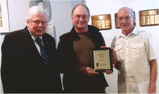 MCHS President Bob Anstine (L), City Forrester Tim Howe (C), and Gil Belles, Cemetery Project Director, present Howe with the 2016 Distinguished Service Award