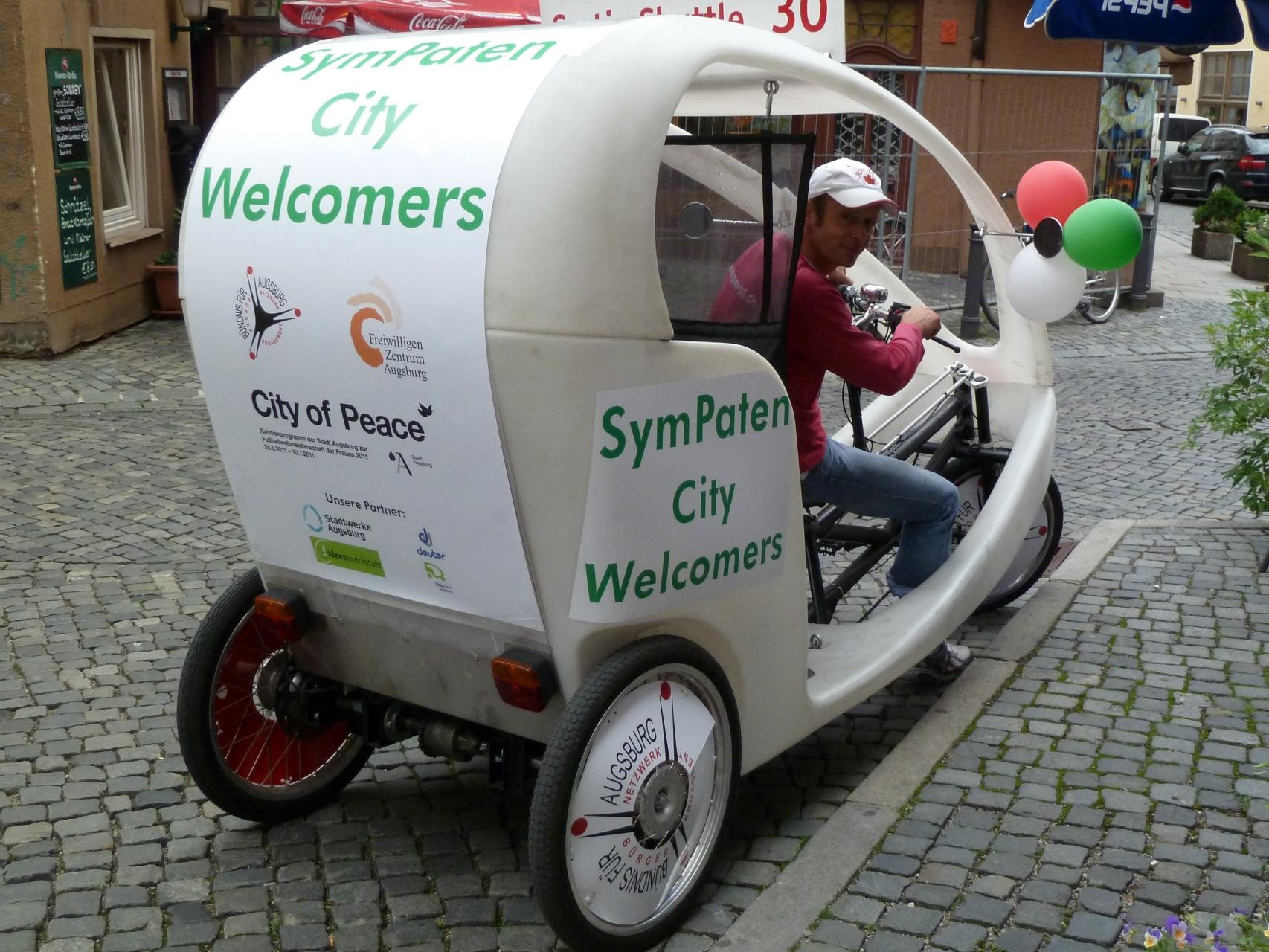 SymPaten - City Welcomers 2011 - Werbung auf Velotaxi Augsburg - Foto: Bernd Beigl - Freiwilligen-Zentrum Augsburg