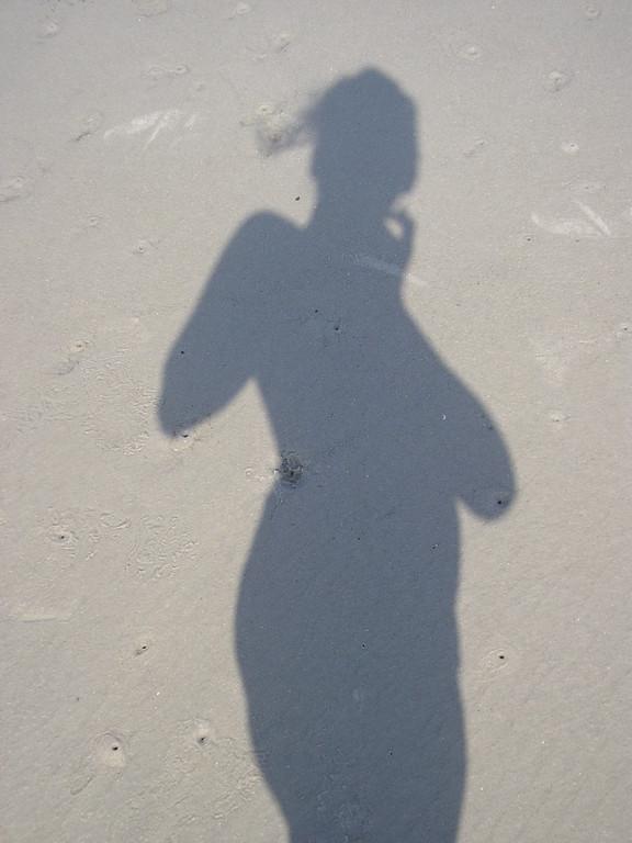 Son ombre,