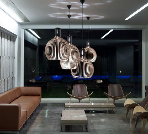 luminaire design octo par secto design dans un salon chaleureux et chic al intérieurs