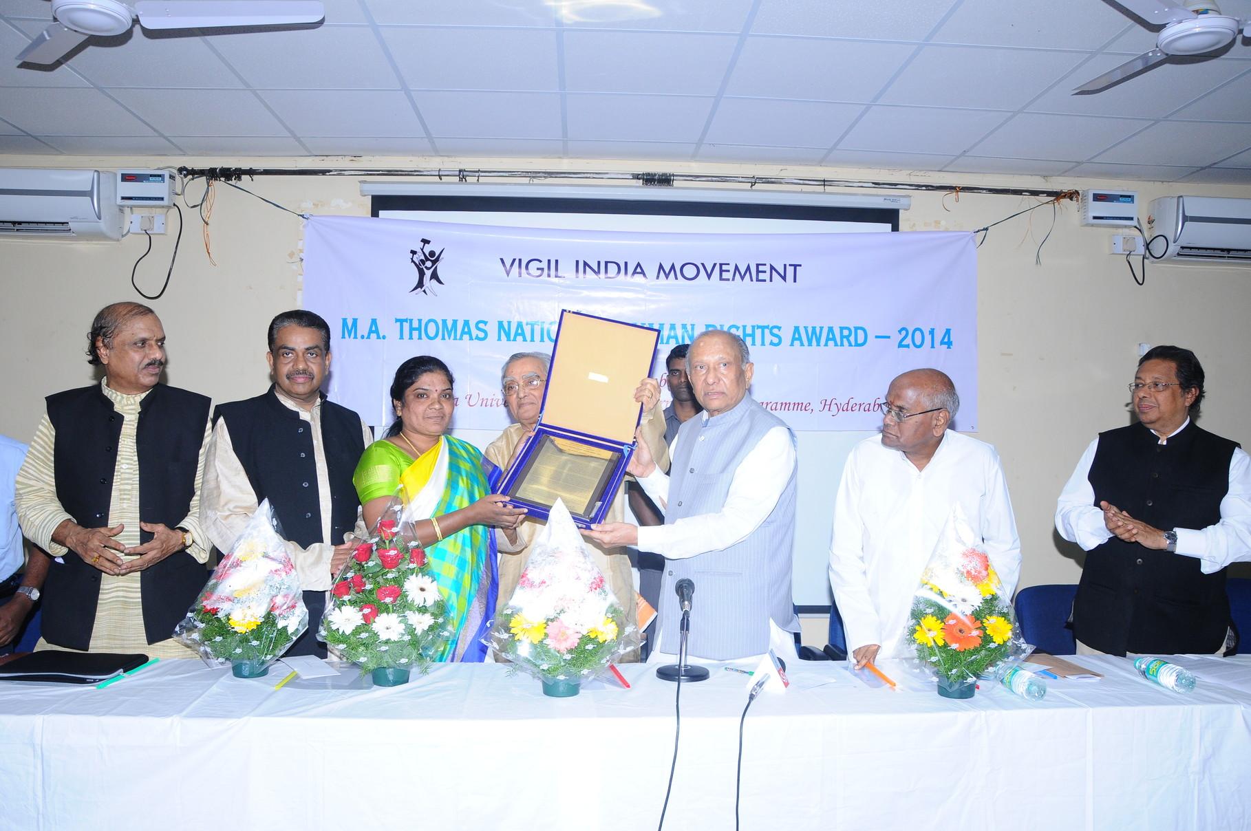 Ms.Bandari.Jayamma,President receives M.A.Thomas National Human Rights Award by the hands of Honorable Chairman,Andhra Pradesh State Legislative Council,Govt.of A.P.,Organized by Vigil India Movement at Centre for International Program,Osmania University