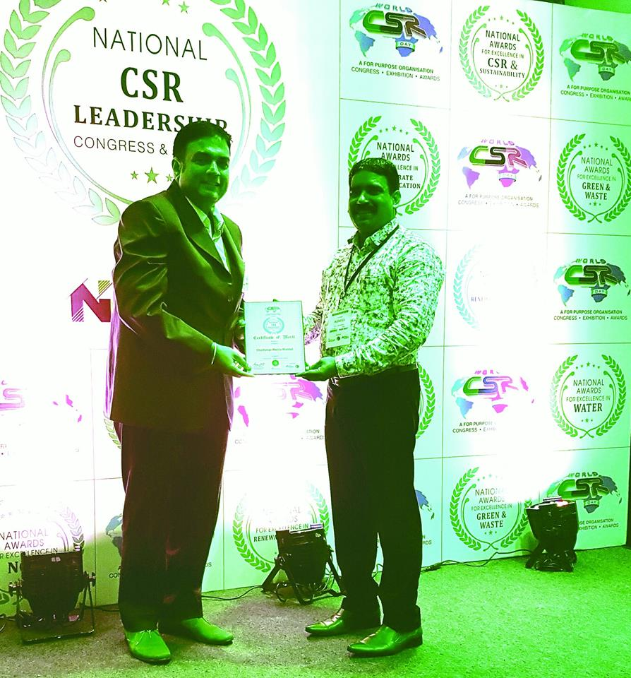 Mr.Jaya Singh.Thomas,Secretary-CMM receives a Certificate of Merit Award -Presented to Chaithanya Mahila Mandali,by World CSR and Sustainability in Banglaore