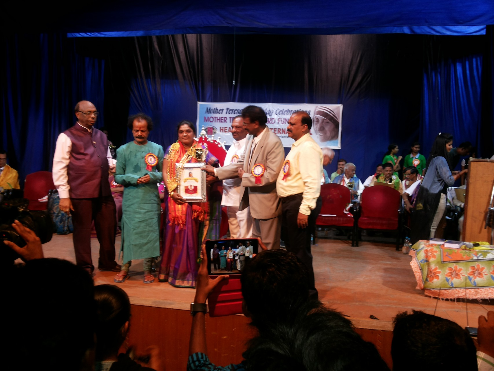Ms.B.Jayamma,President,CMM has been honored with Mother Teresa National Service Award-2015,by the hands of  Hon'ble Chief WHIP Sri.Koppula Eshwer,Government of Telangana in a public meeting on 26th.August.2015 in Hyderabad.