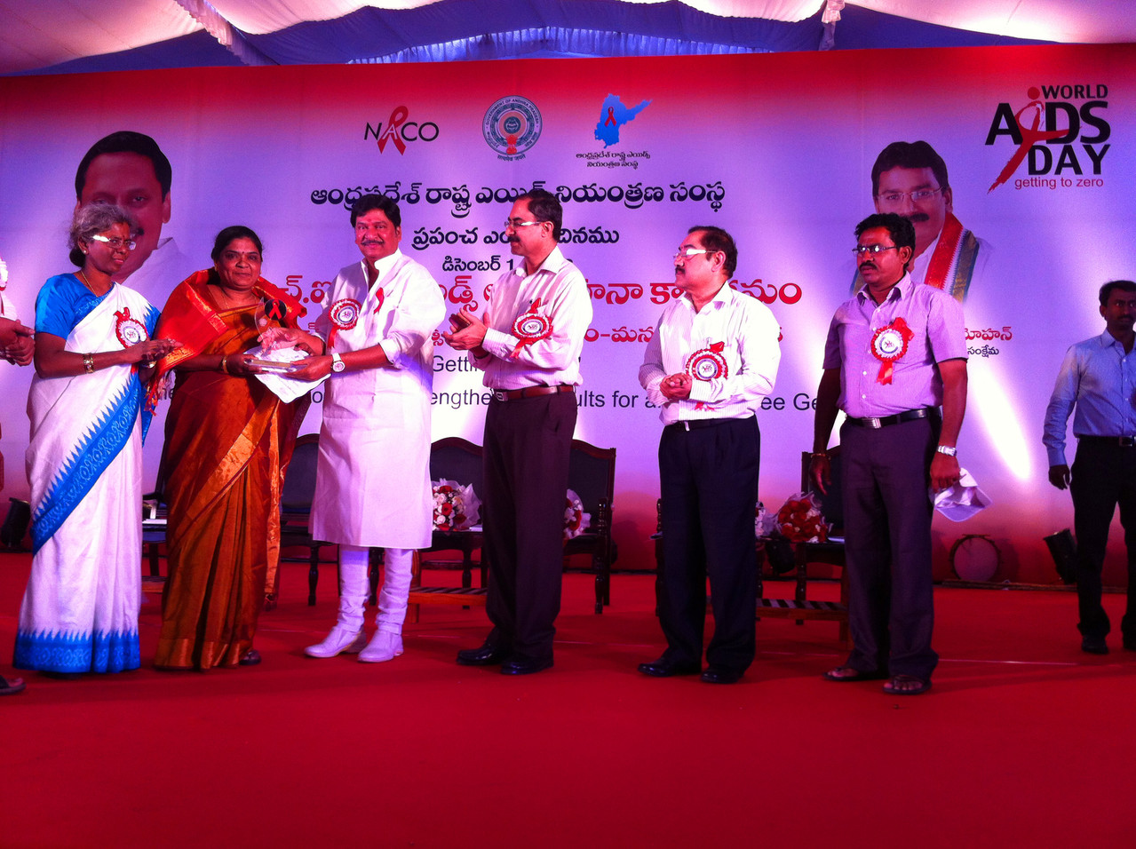 """Ms.Jayamma,President receives on behalf of the Organization :"""" THE BEST CBO LED TI AWARD FROM Andhra Pradesh State AIDS Control Society, Govt.of Andhra Pradesh on World AIDS DAY (Dec.1.2013 at a Public Meeting organized in Hyderabad)"""