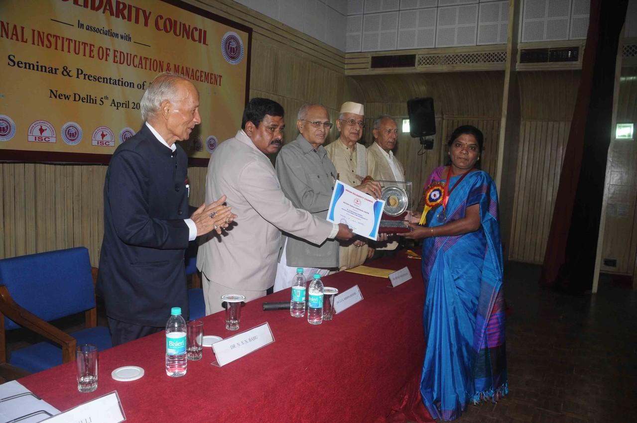 "Ms.Jayamma,President-CMM Receives"" Mother Teresa Shiromani  National Award' at Delhi by Indian Solidarity Council,New Delhi on 5th.April.2013"