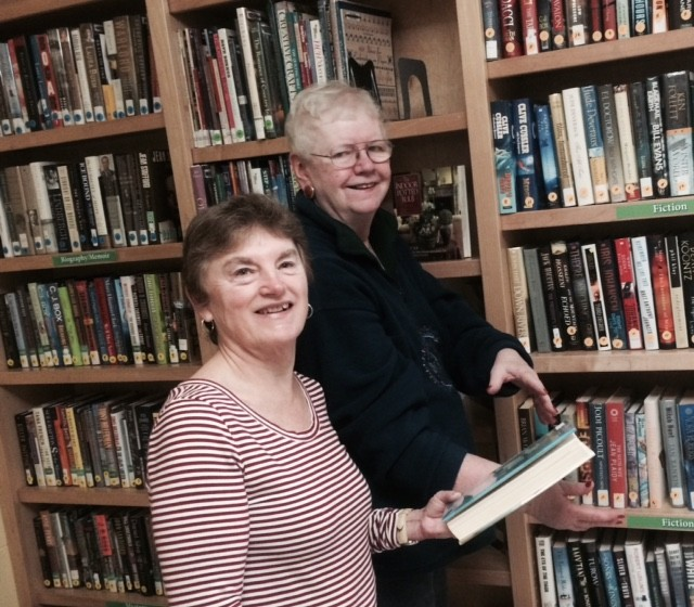 Friends Barbara Webb and Paula Keating keeping Book Nook shelves full