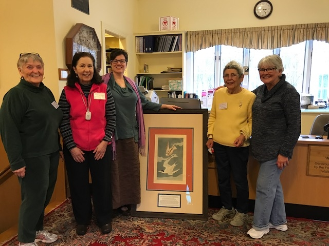 The Audubon Print of terns is unveiled and admired by Joanne Miller, Treasurer of the Friends, Marcia Schleorb, Luncheon Chairman of the Freinds, Antonia Stephens, Director of the Library, Mary Jevdet, Friends Volunteer, and Lori Scudder, Friends Presiden