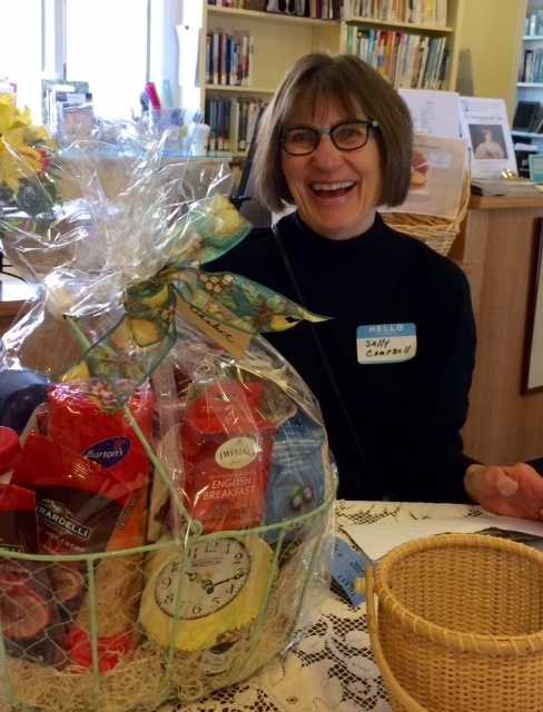Sally Campbell, Board member, drawing the Tea Basket raffle prize.