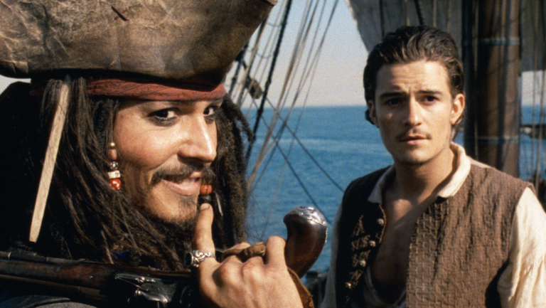 Johnny Depp & Orlando Bloom in Pirates of the Caribbean: The Curse of the Black Pearl
