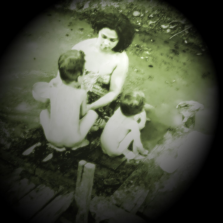 Family washing at the riverside