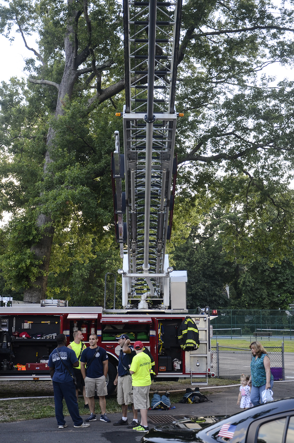 Ladder 1 with its 75' ladder extended over the crowd