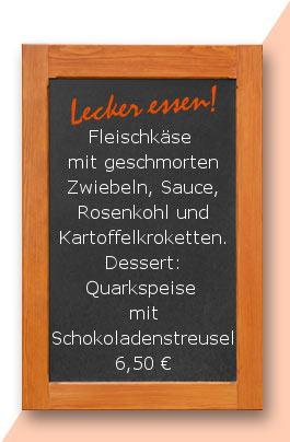 Mittagstisch: Fleischkäse mit geschmorten Zwiebeln, Sauce, Rosenkohl und Kartoffelkroketten. Dessert: Quarkspeise mit Schokoladenstreusel