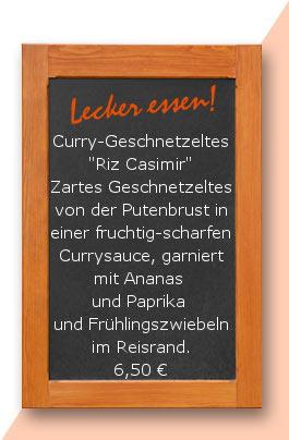 """Mittagstisch Curry-Geschnetzeltes """"Riz Casimir"""" Zartes Geschnetzeltes von der Putenbrust in einer fruchtig-scharfen Currysauce, garniert mit Ananas und Paprika und Frühlingszwiebeln im Reisrand."""