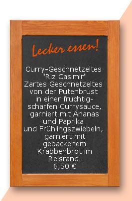 """Mittagstsicch: Curry-Geschnetzeltes  """"Riz Casimir"""" Zartes Geschnetzeltes  von der Putenbrust  in einer fruchtig-scharfen Currysauce, garniert mit Ananas und Paprika  und Frühlingszwiebeln,  garniert mit gebackenem Krabbenbrot im Reisrand. 6,50 €"""