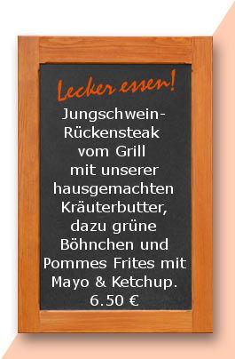 Mittagstisch am Donnerstag den 13.04.2017: Jungschweinrückensteak vom Grill mit unserer hausgemachten Kräuterbutter, dazu grüne Böhnchen und Pommes Frites mit Mayo & Ketchup.