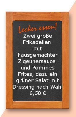 Mittagstisch: Zwei große Frikadellen mit hausgemachter Zigeunersauce und Pommes Frites, dazu ein grüner Salat mit Dressing nach Wahl