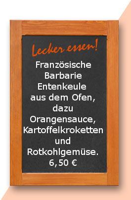 Mittagstisch: Französische Barbarie Entenkeule aus dem Ofen, dazu Orangensauce, Kartoffelkroketten und Rotkohlgemüse.