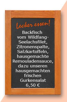 Mittagstisch: Backfisch vom Wildfang-Seelachsfilet, Zitronenspalte, Salzkartoffeln, hausgemachte Remouladensauce, dazu unseren hausgemachten frischen Gurkensalat