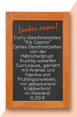 """Mittagstisch: Curry-Geschnetzeltes  """"Riz Casimir"""" Zartes Geschnetzeltes  von der Hähnchenbrust in einer fruchtig-scharfen Currysauce, garniert mit Ananas und Paprika und Frühlingszwiebeln, garniert mit gebackenem Krabbenbrot im Reisrand. 6,50 €"""