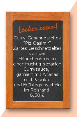 """Mittagstisch:Curry-Geschnetzeltes """"Riz Casimir"""" Zartes Geschnetzeltes von der Hähnchenbrust in einer fruchtig-scharfen Currysauce, garniert mit Ananas und Paprika und Frühlingszwiebeln im Reisrand."""