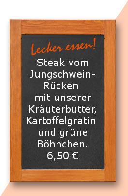 Steak vom Jungschweinrücken mit unserer Kräuterbutter, Kartoffelgratin und grüne Böhnchen.