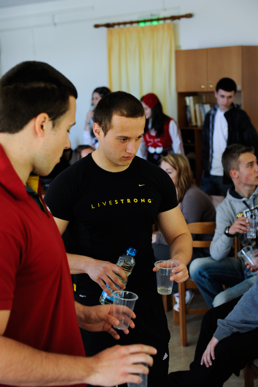 Bulgarians giving others to taste Bulgarian traditional drink