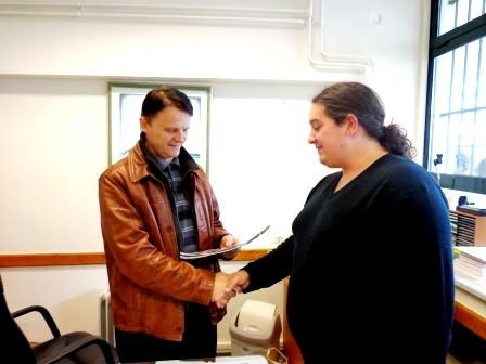Participant of the project presenting calendar to teacher of high school of Igoumenitsa