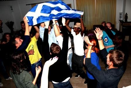 Participants trying to dance Sirtaki dance after the presentation about Greece