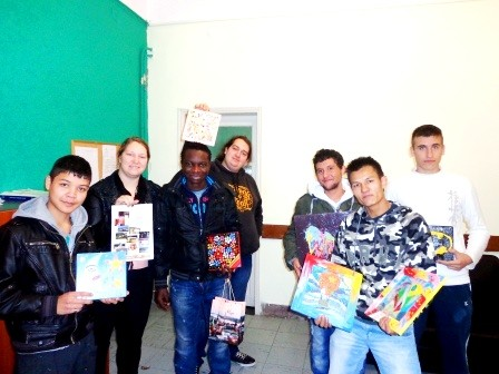 Participants of the project presenting calendar to children of Child Care Center of Konitsa