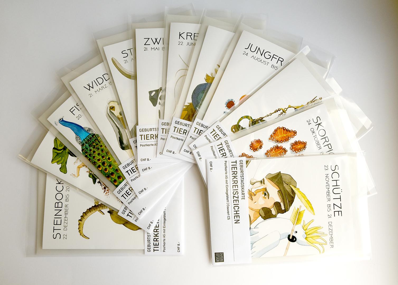 Tierkreiszeichen Geburtstagskarten im Buch am Dorfplatz