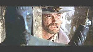 """Clint Eastwood (""""El Bueno"""") mit spanischer Wolfram-Kopie (Bildquelle:  www.uni-erfurt.de / Max-Weberkolleg, Vortrag Nobert Schmid, Was hat Clint Eastwood mit dem Erfurter Wolfram-Leuchter zu tun?)"""